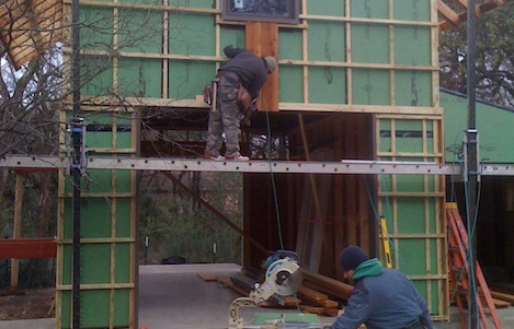<p>Installing the vertical and horizontal boards for the rain screen.</p>