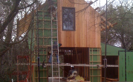 <p>Here you can see half of the cedar lap and gap siding going on to create the finished vented system</p>